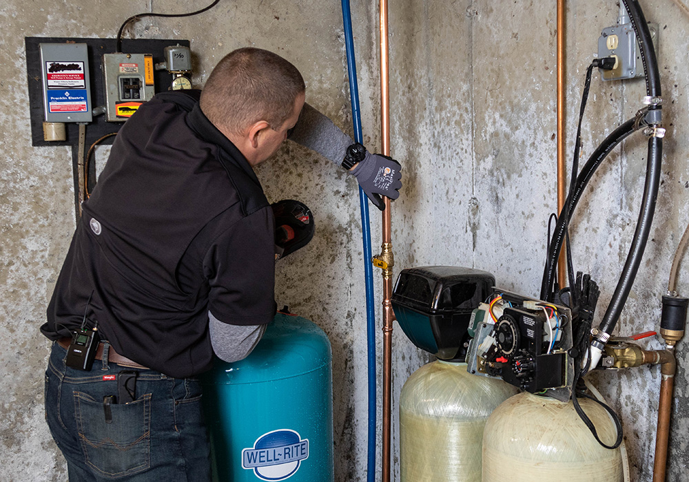 Jeff Installing a Water Softening System in a Seacoast NH home
